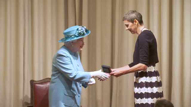 Professor Tessa Holyoake with queen